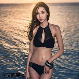 Bikinis calientes coreanos online-Bikini traje de baño, traje de baño de damas europeo y americano, traje de baño sexy color puro, versión coreana del traje de baño Bikini Beach Hot Spring.