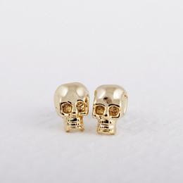 Argentina Pendientes de botón de oro de la manera SKULL pendientes románticos pendientes de aleación de zinc Pendientes de botón de oro para las mujeres al por mayor cheap gold skull studs wholesale Suministro