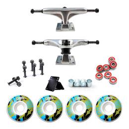 Tamanhos de vedação on-line-Rodas do skate e 5inch skate caminhão rolamentos hard wares gaxeta de borracha riserpad 100A impressão PU rodas tamanho 52 mm * 30 mm