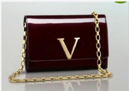 Wholesale Designer Leather Cowhide Handbags - Free shipping! wholesale famous designers bag with cowhide genuine leather wristlet for women handbags M94336
