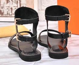 sandalias doradas de fiesta Rebajas 2018 verano popular de lujo de las señoras de la lona del estilo del gladiador pisos zapatos negros de oro de los pernos prisioneros de las mujeres del nómada de la fiesta del partido sexy zapatos de las señoras de la manera