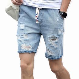 tattered shorts men