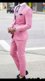 pantalon rose élégant Promotion Tuxedos Groom Design élégant un bouton rose Peak revers garçons d'honneur meilleur costume homme costumes de mariage pour hommes (veste + pantalon + cravate) 527