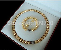 Argentina Jewelry 00797 Rare 10 mm real del mar del sur de oro Shell Pearl Necklace pulsera pendientes Set AAA cheap rare bracelet Suministro