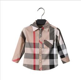 chemise à carreaux vente chaude 2018 européenne et américaine nouvelle  arrivée automne à manches longues revers chemise de haute qualité pur coton  garçons ... f7fa0d269cb