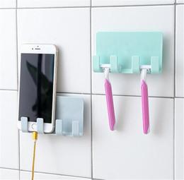 Teléfonos celulares online-Práctico Adhesivo para montaje en pared Soporte para carga de teléfono Adhesivo pegajoso fuerte Carga para teléfonos celulares Sopport Rack Shelf con ganchos