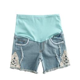 Argentina Nuevas mujeres embarazadas pantalones cortos de mezclilla pantalones de maternidad de encaje de moda pantalones embarazadas ropa embarazada verano ropa de maternidad grossesse Suministro