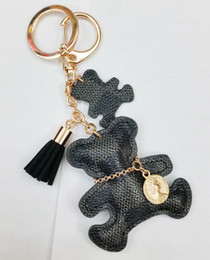 Portachiavi della borsa dell'automobile del portachiavi della nappa dell'anello chiave della catena chiave dell'orso di cuoio dell'unità di elaborazione di nuova moda per il regalo degli accessori dei gioielli delle donne da