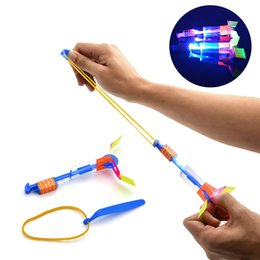 Wholesale Led Amazing Arrow Helicopter - Helicopter Rotating Fly Arrow Toys Amazing Elastic Powered LED Flying Toy Children Xmas Gifts 0 38h C R