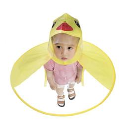 Gelbe regenmantel kinder online-Kinder-Regenmantel-Regenschirm-nette gelbe Ente UFO-Form-Regen-Hut-Umhang-Baby-Körper-Abdeckungs-kreative Kinderregenmantel-Kappe S3