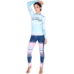 Traje de buceo de lycra online-Las mujeres al por mayor de la manera Lycra firmemente de manga larga Surf traje de buceo Rashguards traje de baño Rash Guard protector solar natación camisa pantalones largos