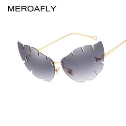 72033a846d9 2019 lunettes en forme de papillon MEROAFLY sans monture chat yeux lunettes  de soleil femmes marque