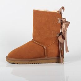 Argentina Botas de nieve para adultos Arco nudo Botas de cuero genuino para adolescentes Zapatos de invierno con cordones para mujer Calzado de nieve cheap teenager shoes Suministro