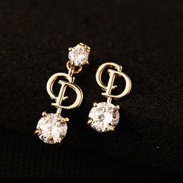2019 gros bijoux de fantaisie en or S.vex 2017 Top Qualité Asymétrique Boucles D'oreilles Or D Lettre Boucle D'oreille De Mode Cristal Bijoux pour Femmes Cadeau ER404