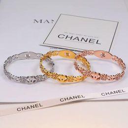 2018 Venta caliente Big Promotion Brazalete Twist simple Abra los brazaletes 9 colores para las opciones Metal Tie Knot heart Bracelet Bangle jewelry # 03 desde fabricantes