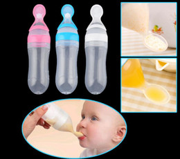 Wholesale Feeding Babies Rice - Infant Baby Silicone Feeding With Spoon Feeder Food Rice Cereal Bottle Feeding Squeeze Silicone Spoon Bottle Training Feeder KKA3860