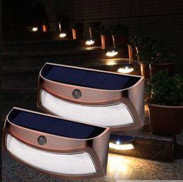 Iluminação conduzida ao ar livre da cerca on-line-Ao ar livre Luzes LED de Parede Solar 8led 250lm Auto Crepúsculo ao Amanhecer Sem Fio À Prova D Água Baterias Incluídas Luzes Cerca de Segurança Marrom