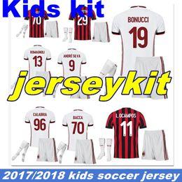 Wholesale Children Size Jerseys - 2018 home Kids Soccer Jersey 17 18 AC Milan child Soccer Shirt Customized #10 CALHANOGLU #9 ANDRE SILVA football uniform Sales size S-XXL