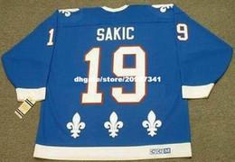 Venta al por mayor Mens JOE SAKIC Quebec Nordiques 1992 CCM Vintage Away Cheap Retro Hockey Jersey desde fabricantes