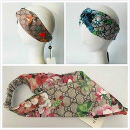 Flores de seda para headbands on-line-Melhor qualidade mulheres headband flor pássaro marca de luxo headband moda mulheres headbands carta de seda Elastic Cross hairband