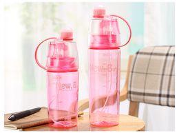 2019 bottiglie d'acqua per bambini Bottiglia di acqua di spruzzatura bevente di sport dei bambini della bottiglia dello spruzzo 400ml / 600ml dei bambini portatile DHL libera il trasporto sconti bottiglie d'acqua per bambini