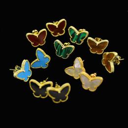 Brincos para os tigres on-line-Quatro folhas de flores série jóias preço de atacado requintado cobre banhado a ouro em forma de borboleta shell olho de tigre pedra Do Parafuso Prisioneiro Do Trevo Brincos