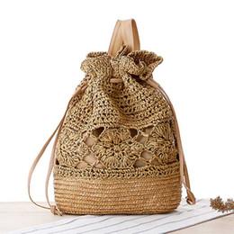Las mujeres hechas a mano mini mochila bolsa de paja de alta calidad casual de estilo preppy Girls viajan bolso de la playa mochila tejida Escolar desde fabricantes