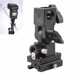 schnelle schlinge kamera Rabatt Freeshipping Universalart B Blitzschuh-Regenschirm-Halter-Schwenker-Licht-Standplatz-Klammer für Kamera