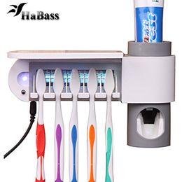 Canada 3-in-1 Distributeur de brosse à dents porte-brosse à dents et ensemble de stérilisateur pour brosse à dents cheap toothbrush mount Offre