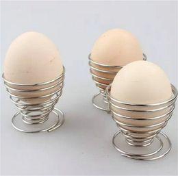 Cremagliera da cucina online-Supporto a molla in acciaio inox Boiledc Reative Eggs Holder Rack Tazza portatile antiusura Vassoio filo squisito Cucina Utensili da cucina 0 8hc jj