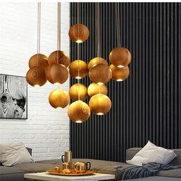 sombra colgante rojo Rebajas 2017 lámpara de madera maciza moderna china japonesa nórdica creativa minimalista sala de estar comedor tres lámpara de madera de una cabeza