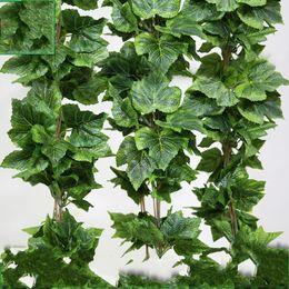 Decoração de flores de parede pendurada de seda on-line-Simulação de Folha de Uva Rattan Lvy Artificial Silk Leaves Planta Verde Pendurado Na Parede Decorar a Flor Rattan Home Decor 2rx gg