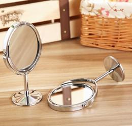 Espejo cosmético de cristal Espejos de maquillaje de doble cara con función de aumento 1: 2 Espejo giratorio de escritorio Decoración para el hogar 6 diseños 50pcs YW1635 desde fabricantes