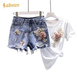 Pantalones cortos de mezclilla Pantalones Trajes 2018 Mujeres Diamante de verano rebordear 3D Camiseta de algodón de la flor Tops + Short Jeans Ropa Set Mujer XZ281 desde fabricantes