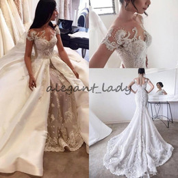 Свадебное платье из шеи жемчуга онлайн-Steven Khalil Overskirts Wedding Dresses Bridal Gowns Lace Pearls Sheer Crew Neck Cap Sleeves Button See Through Back with Removable Skirt