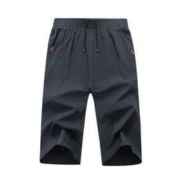 2018 nuevo 130 kg de gran tamaño 6XL 7XL 8XL 9XL cortocircuitos de los hombres de secado rápido Mens Sweatpants Beach Male Sporting Shorts desde fabricantes