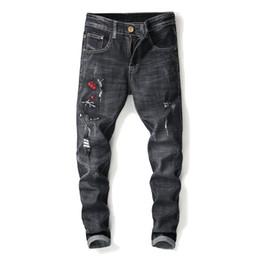 jeans gordo Rebajas 2018 jeans de otoño bordado de los hombres agujero de lujo  Jeans Hombres 15ba4585baf