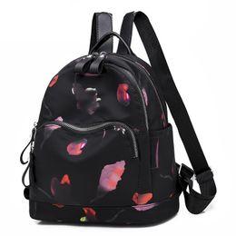 7ade5055741d2 schwarze rucksäcke Rabatt Oxford Frauenrucksack Blumendruck Lässiger  Rucksack Weibliche Schultaschen für Mädchen zurück Tasche Damen Rucksack