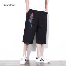 Pantalones de gran tamaño M-5XL hombres sueltos Casual Pantalones bordados  de estilo masculino de China Harem Pantalones de verano de pierna ancha  suelta ... 36dd84e032d