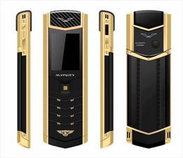 MPARTY LT2 Luxe Or Métal Corps En Cuir Logement Mobile Téléphone Double Sim Téléphones Mobiles Bluetooth FM Mp3 Caméra ? partir de fabricateur