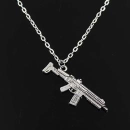2019 fusil de asalto Sencillo clásico de la manera ametralladora rifle de asalto de plata antiguo colgante de niña corto cadena larga collares joyería para mujeres fusil de asalto baratos