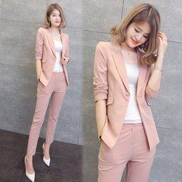 Modelo de las mujeres de la oficina online-Traje de dos piezas de color rosa naranja pantalones de punto cardigan primavera y otoño XL traje de damas de la oficina