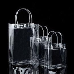 Chiari borse di regalo borse online-10pcs sacchetti regalo di plastica in PVC con manici sacchetti di plastica di imballaggio del vino borsa chiara borsa di favore di partito borsa PP con il tasto