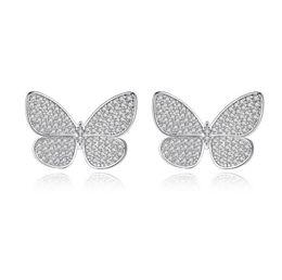 Mariposa brillante online-Moda antialérgico pendientes de diseño de mariposas de oro blanco cz pendientes cristalinos del perno prisionero para las mujeres que brillan los pendientes de la circona cúbica joyería de la broche