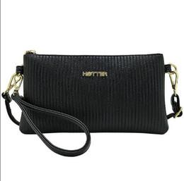 Высокие продажи дамы полосатый тиснением повседневная мода корейский мягкое лицо сумка ручной телефон сумка от Поставщики корейский телефон продажа