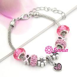 Braccialetto fiore da discoteca online-10pcs / lot il più nuovo braccialetto europeo del branello del fiore pavimenta i braccialetti di fascino del cuore di cristallo rosa del cancro al seno della discoteca per le donne