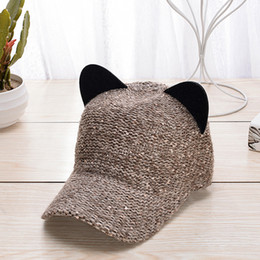 Nueva moda de lana de punto orejas de gato otoño e invierno cálido color  sólido sombrero de béisbol casquillo salvaje salvaje lindo a5b68e54291