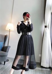 Otoño e invierno coreano nuevo patrón solapa rompevientos suelta capa + gasa medio cuerpo falda incluso falda traje Y1138 desde fabricantes