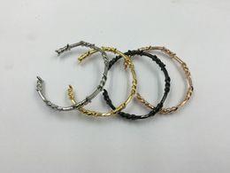 Brazalete de oro online-Hombres Femal Twist Thorns Brazaletes Brazalete Negro Gold-color Love Bracelet Manchette Hombres Brazaletes Pulseras