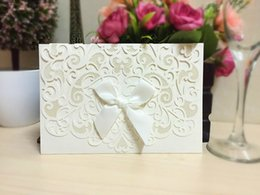 Wholesale Black Red Invitations - Wholesale 100 pcs lot Printing Laser Cutting 2018 Wedding Invitation Cards with Bow Hollow Wedding Favors